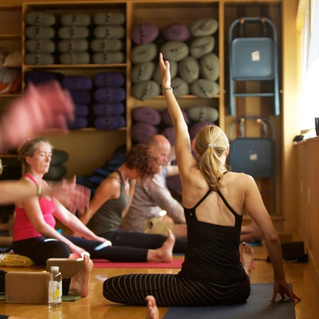 Erika, yoga instructor, leading people in yoga class