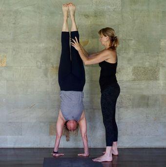 erika helping student teacher do a handstand