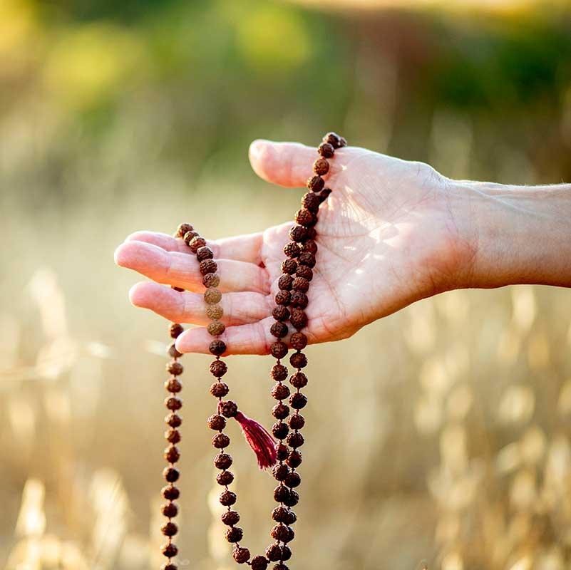hand holding beads