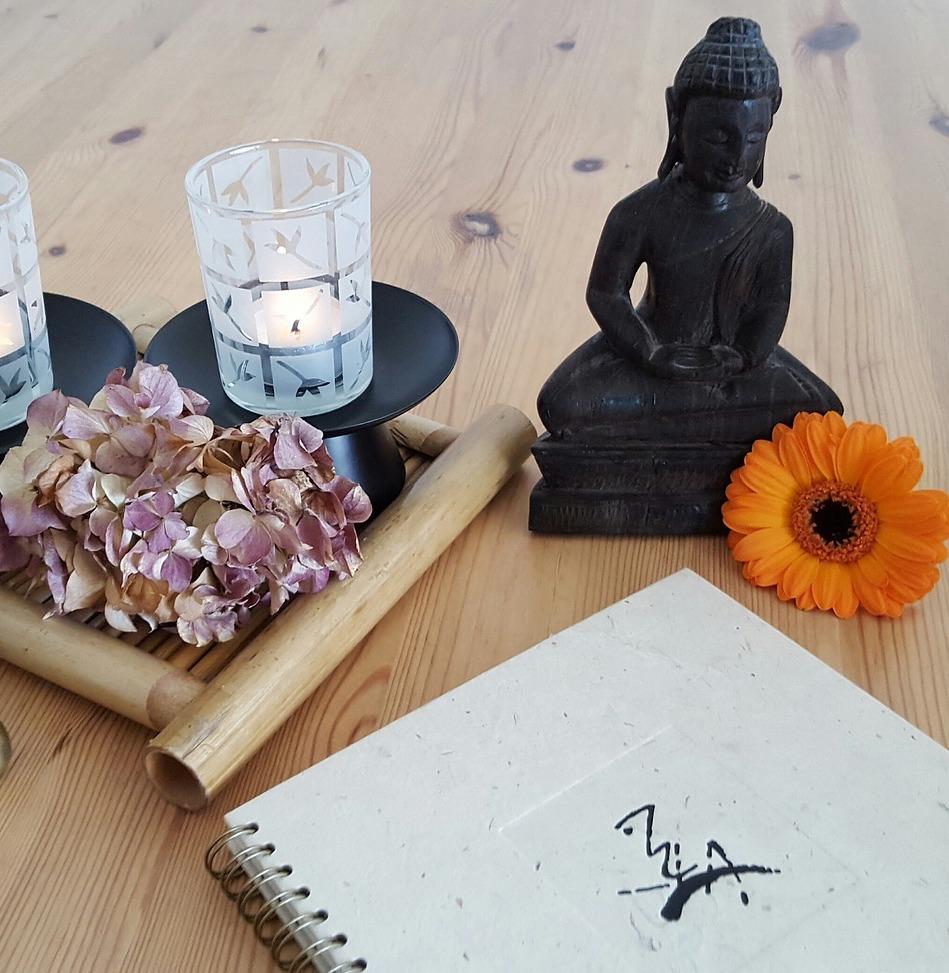 buddha and journal on table